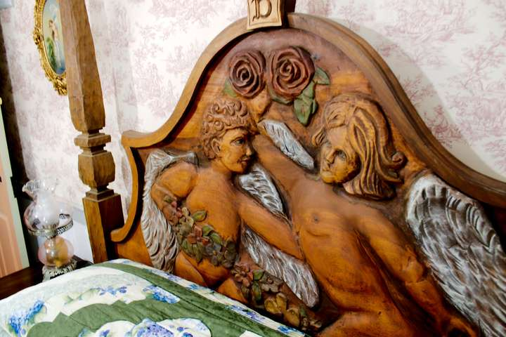 Close-up of the carved wood headboard.