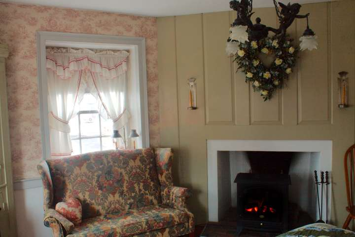 Wide view of the couch and fireplace.